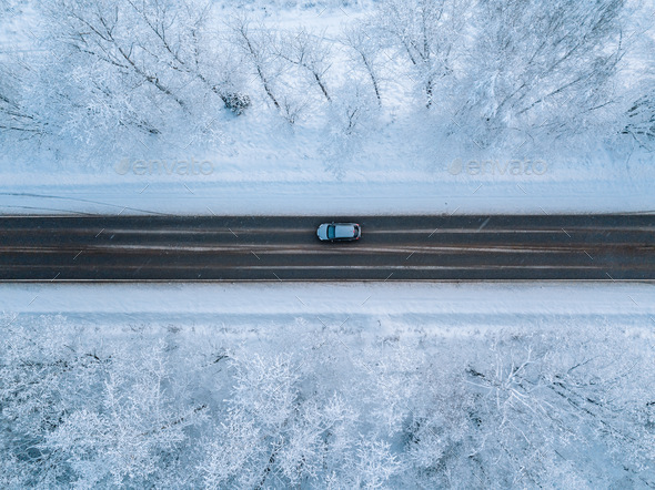 Aerial view of a winter road with snow forest - Stock Photo - Images