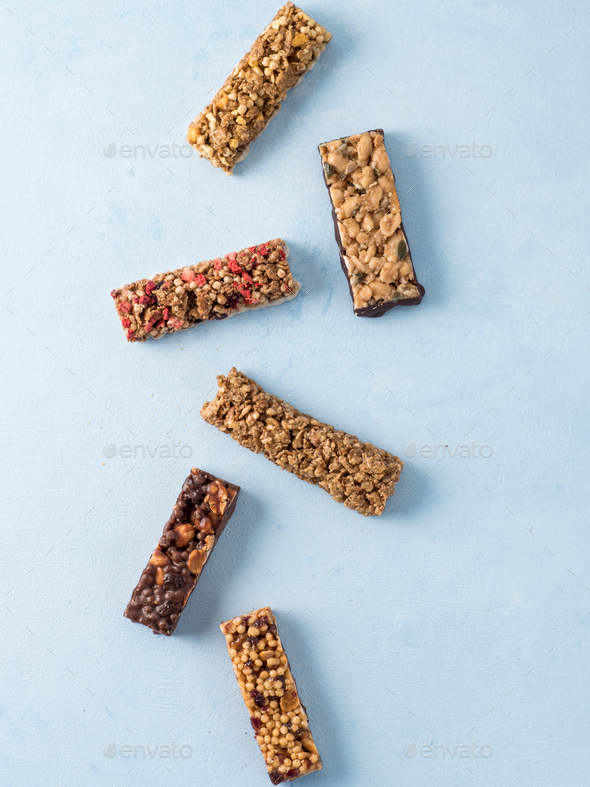 Set of different granola bars on blue background - Stock Photo - Images