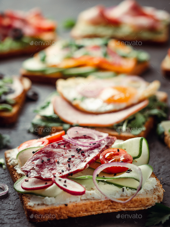 sandwiches with salami, vegetables and black sesame - Stock Photo - Images