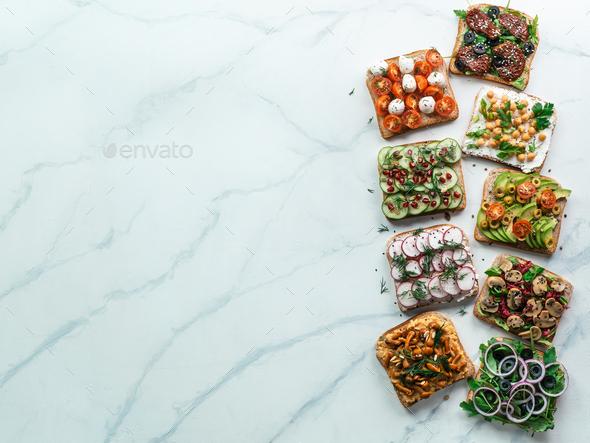 Assortment vegan sandwiches on white marble - Stock Photo - Images