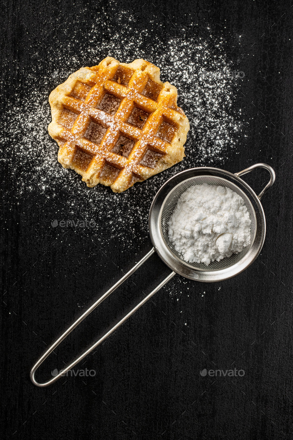 Belgian waffles sprinkled with sugar. - Stock Photo - Images