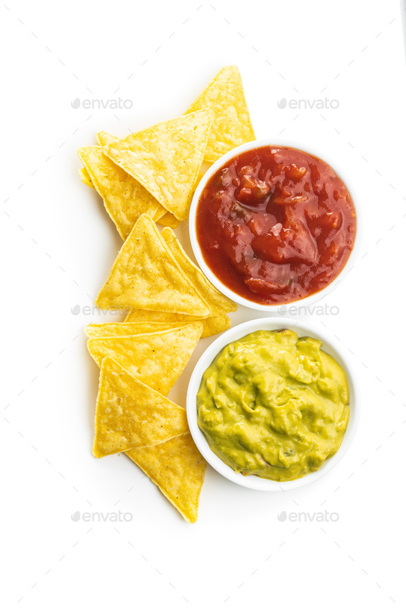 Corn nacho chips with avocado and tomato dip. - Stock Photo - Images