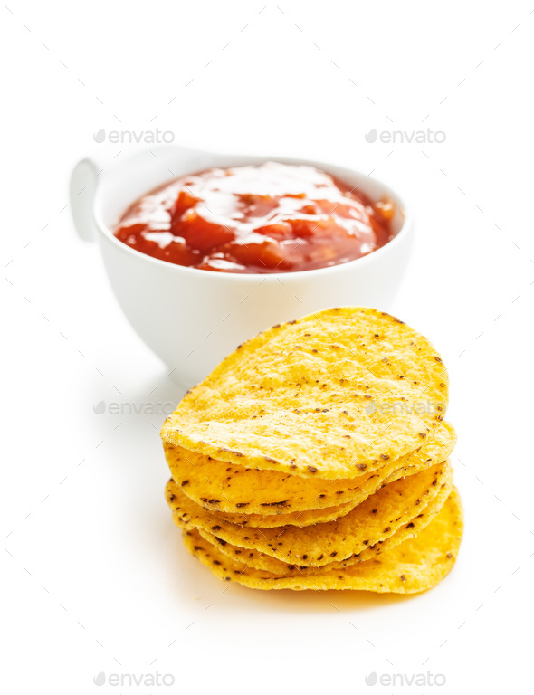 Round corn nacho chips and tomato dip. Yellow tortilla chips and salsa - Stock Photo - Images