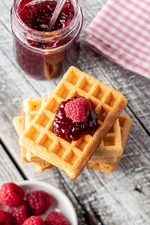 Tasty sweet waffles with raspberries and jam. - Stock Photo - Images