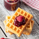 Tasty sweet waffles with raspberries and jam. - PhotoDune Item for Sale