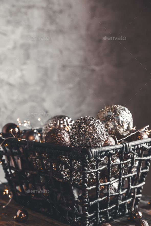 vintage christmas, new Year toys and decoration in basket on brown wooden table with garlands - Stock Photo - Images