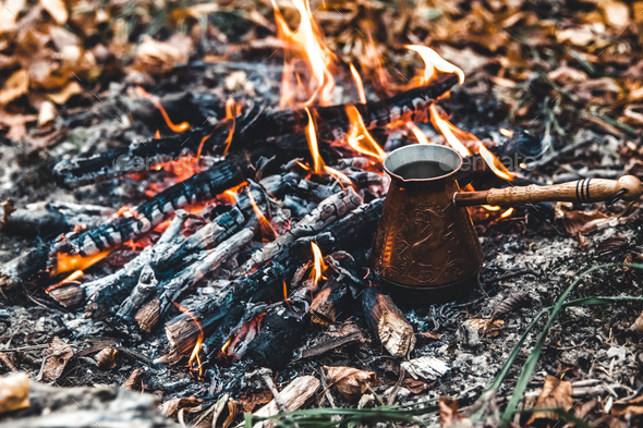 Making coffee at the stake. Make coffee or tea on the fire of nature. Burned fire. A place for fire - Stock Photo - Images