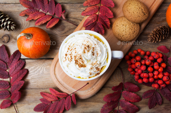 Pumpkin spice latte mug with whipped cream, top view - Stock Photo - Images