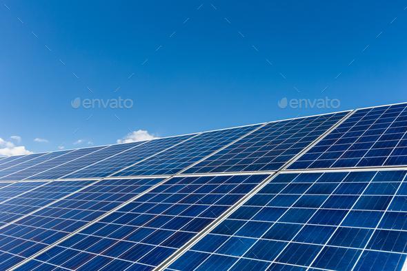 solar panels against a blue sky - Stock Photo - Images