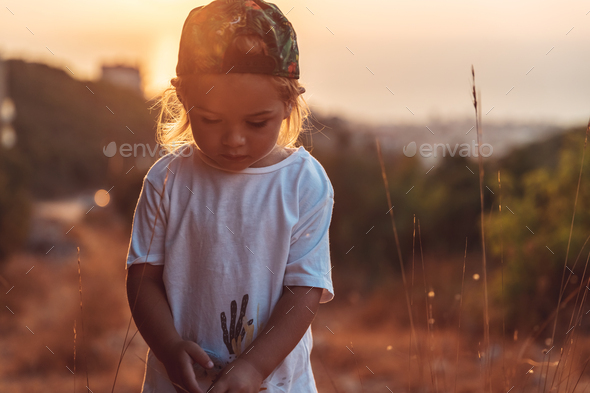 Cute little boy on the walk - Stock Photo - Images