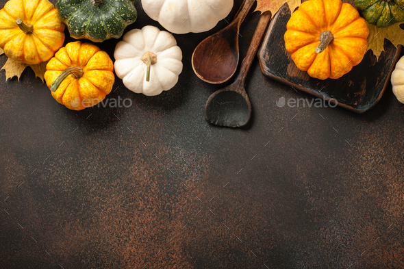 Happy Thanksgiving background with decorative pumpkins and vintage wooden spoons - Stock Photo - Images