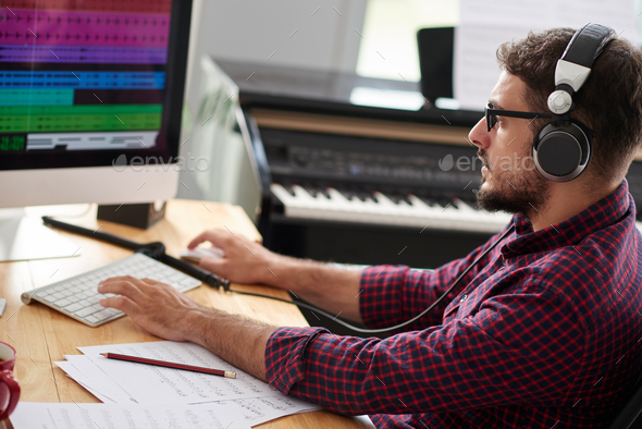 Composer listening to new song - Stock Photo - Images