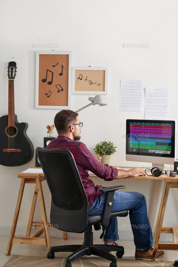 Man working at recording studio - Stock Photo - Images