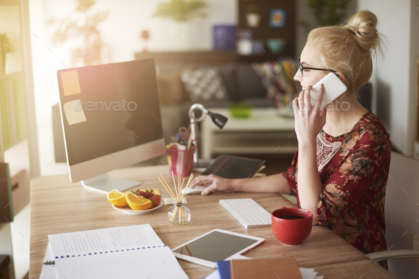 Woman in surroundings of digital technology - Stock Photo - Images