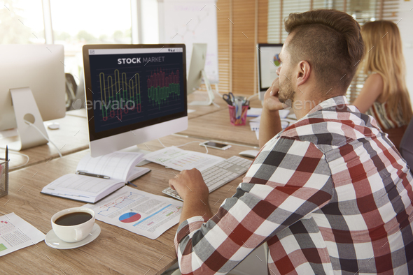 Man analyzing some data on computer - Stock Photo - Images