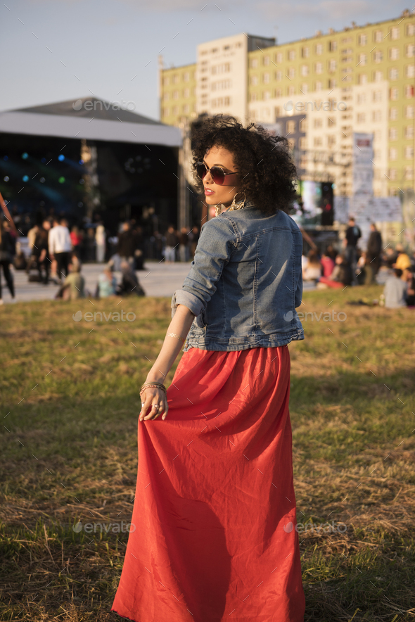 Fashionable girl at the music concert - Stock Photo - Images