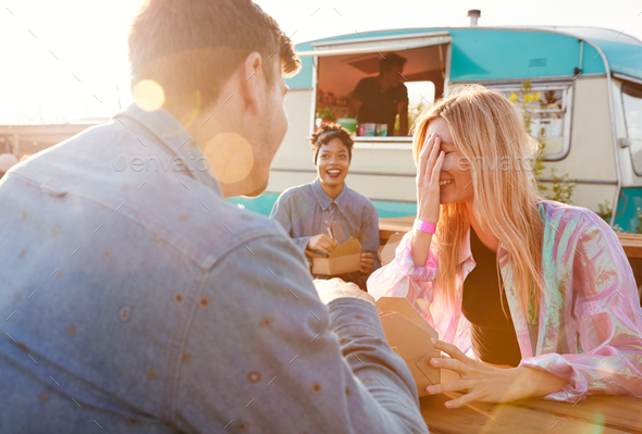 Group Of Friends Eating Takeaway Food From Truck At  Outdoor Music Festival - Stock Photo - Images