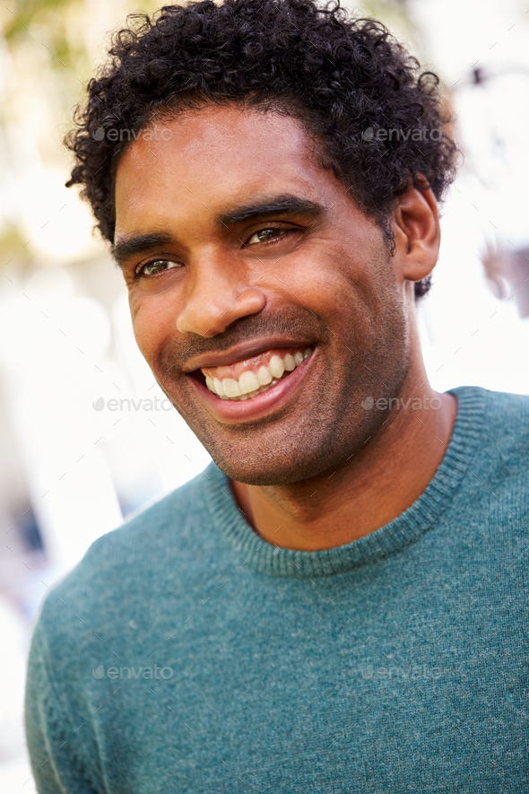 Outdoor Portrait Of Smiling Man In Garden At Home