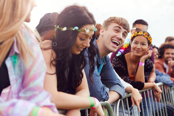 Group Of Young Friends Waiting Behind Barrier At Entrance To Music Festival Site - Stock Photo - Images