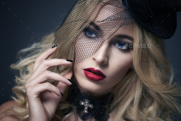 Pretty face of woman wearing black veil - Stock Photo - Images