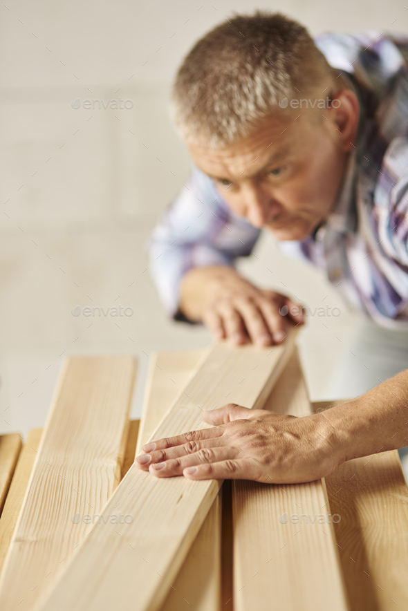 Very hard working man meausers another planks - Stock Photo - Images