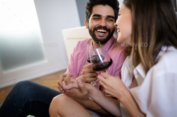 Intimate sensual young couple in bedroom enjoying each other - Stock Photo - Images