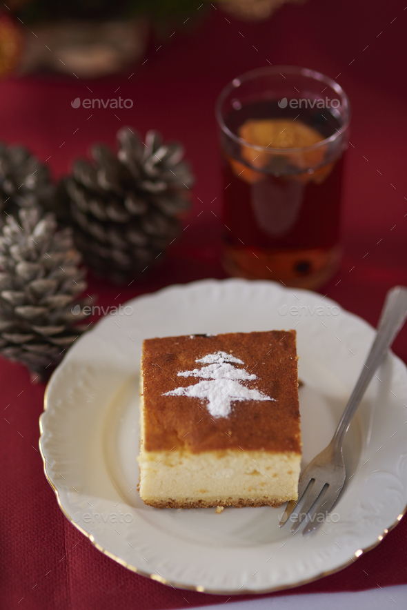 Powdered sugar shape on cheesecake piece - Stock Photo - Images