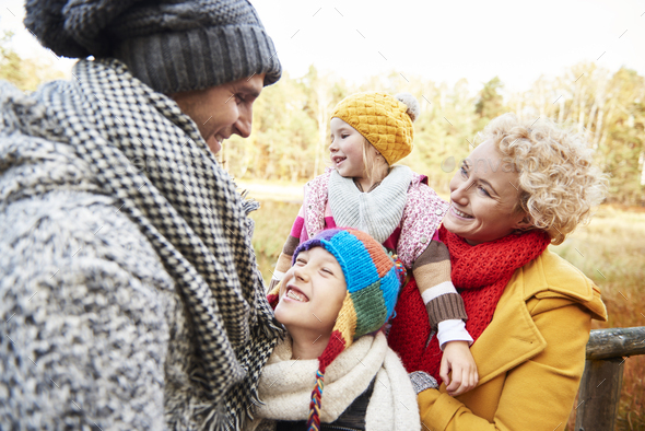 Family having a walk in autumnal forest - Stock Photo - Images