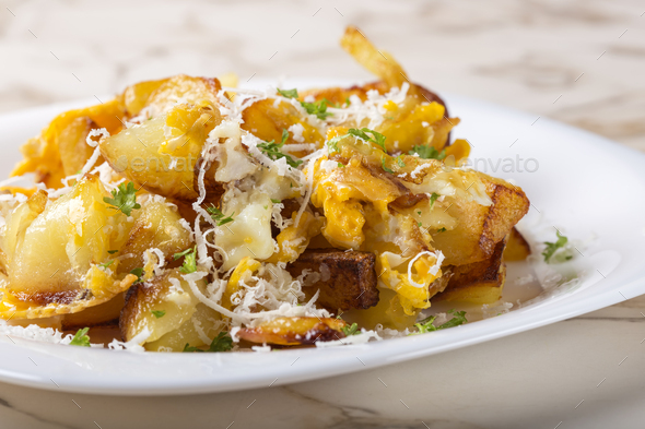 Fries with smashed eggs and parmesan - Stock Photo - Images