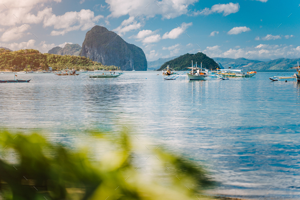 Beautiful tropical scenery. El-Nido, Philippines. Banca boats resting on tranquil early morning at - Stock Photo - Images