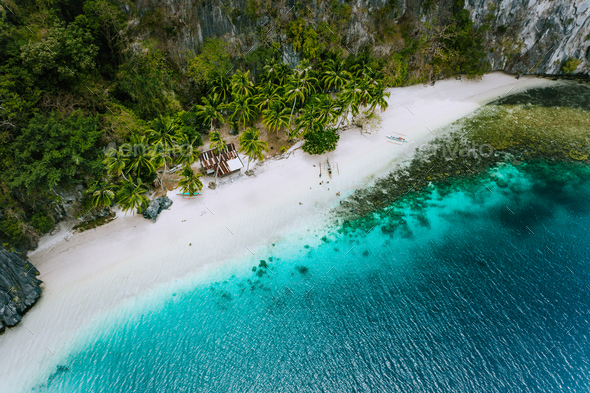 Aerial drone view of abandoned house hut on Pinagbuyutan Island in El Nido. Amazing white sand beach - Stock Photo - Images