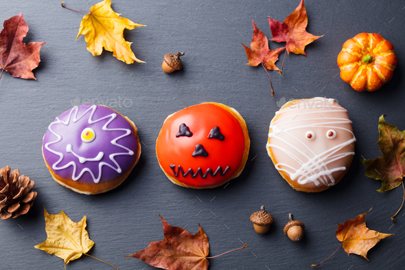 Donuts with Halloween Decoration on Black Slate Background. Top View. - Stock Photo - Images
