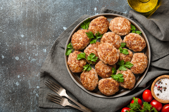 Homemade meat patties on ceramic plate - Stock Photo - Images