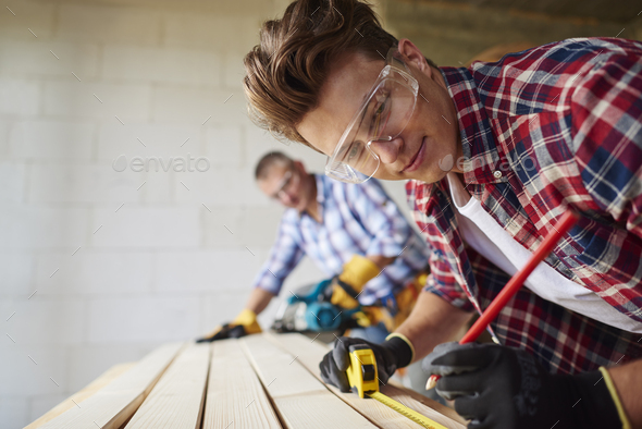 Young carpenter is creating something new - Stock Photo - Images