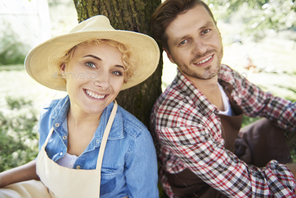 Couple of farmers taking a break - Stock Photo - Images