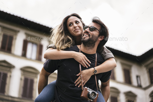 Couple in love visiting Florence Italy and enjoying most famous landmarks - Stock Photo - Images