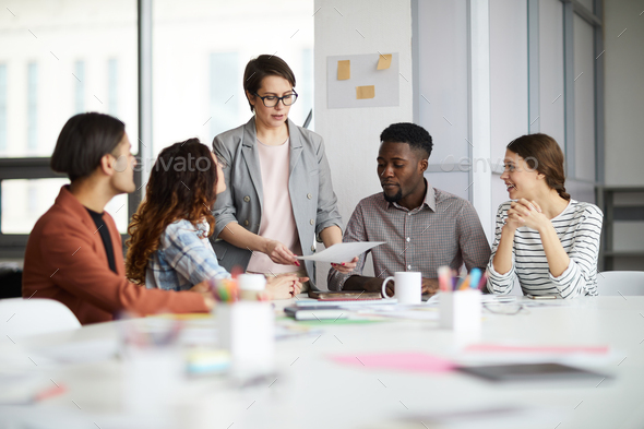 Female Manager Working with Creative Team - Stock Photo - Images