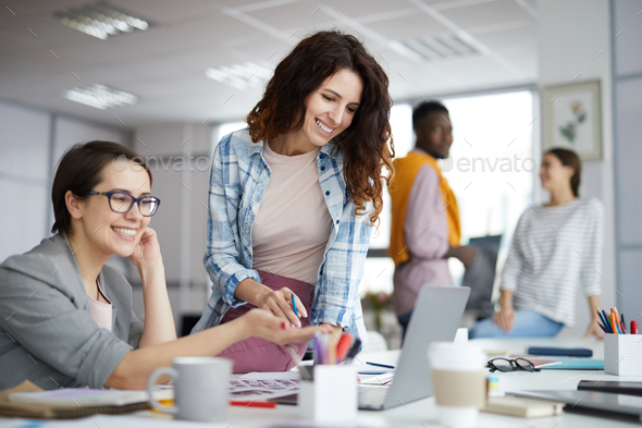 Smiling Businesswoman Working in Office - Stock Photo - Images