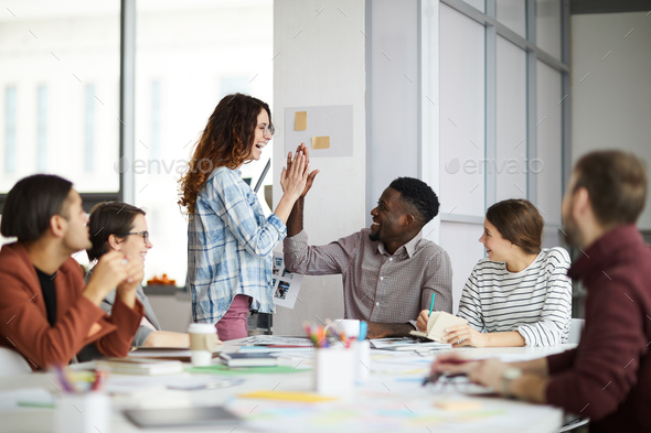 Creative Team High-Five in Meeting - Stock Photo - Images