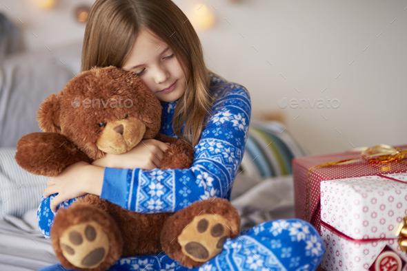 Small girl bonding teddy bear in Christmas - Stock Photo - Images