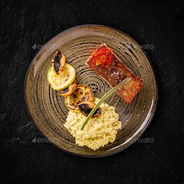 Grilled salmon served with risotto - Stock Photo - Images