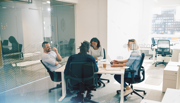 Laughing group of office colleagues having an work meeting together - Stock Photo - Images