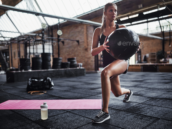 Fit woman exercising at the gym with a swiss ball - Stock Photo - Images