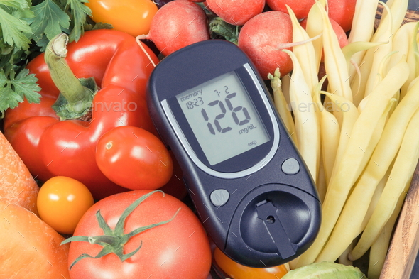 Glucometer with fresh vegetables as source minerals and vitamins - Stock Photo - Images