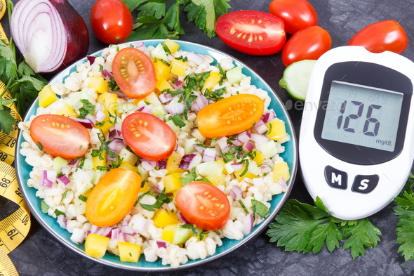 Glucometer with sugar level, salad with vegetables and bulgur groats, tape measure - Stock Photo - Images