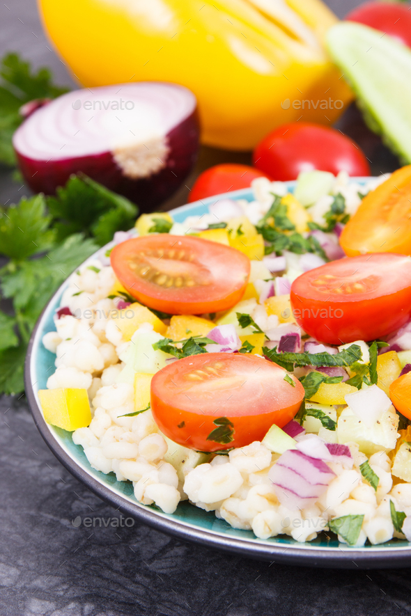 Fresh salad with bulgur groats and vegetables as best food for dieting and slimming - Stock Photo - Images