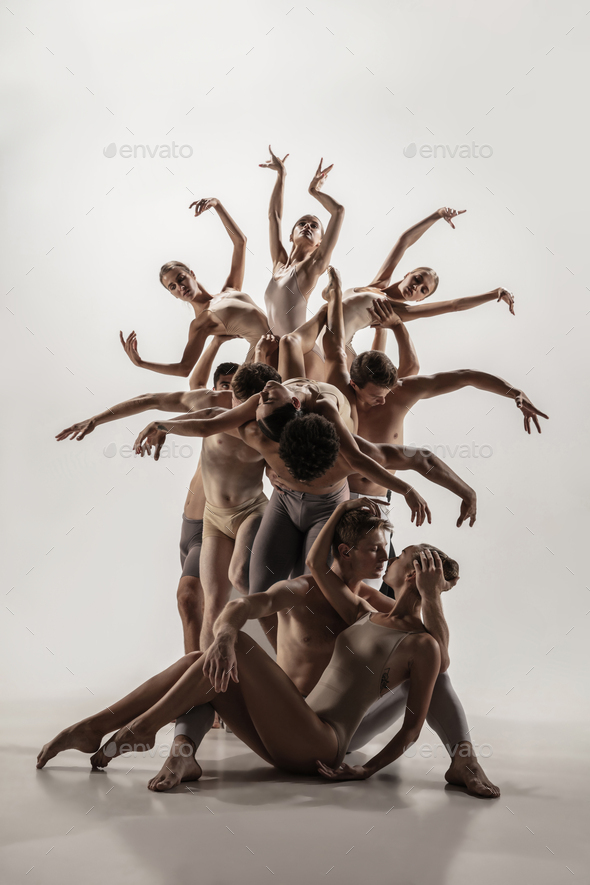 The group of modern ballet dancers. Contemporary art ballet. Young flexible athletic men and women - Stock Photo - Images