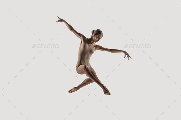 Modern ballet dancer. Contemporary art ballet. Young flexible athletic woman - Stock Photo - Images