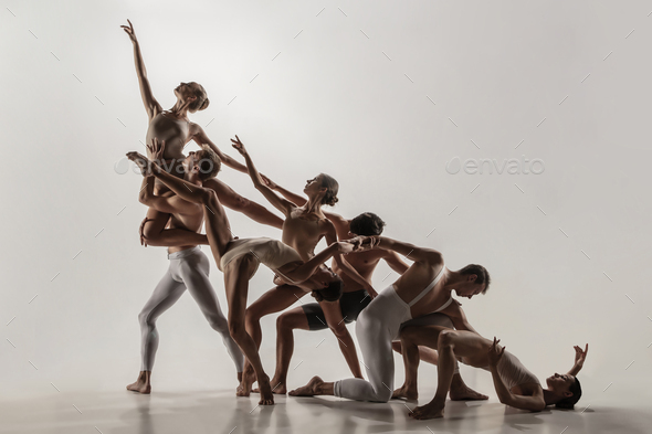 The group of modern ballet dancers. Contemporary art ballet. Young flexible athletic  men and women Stock Photo by master1305