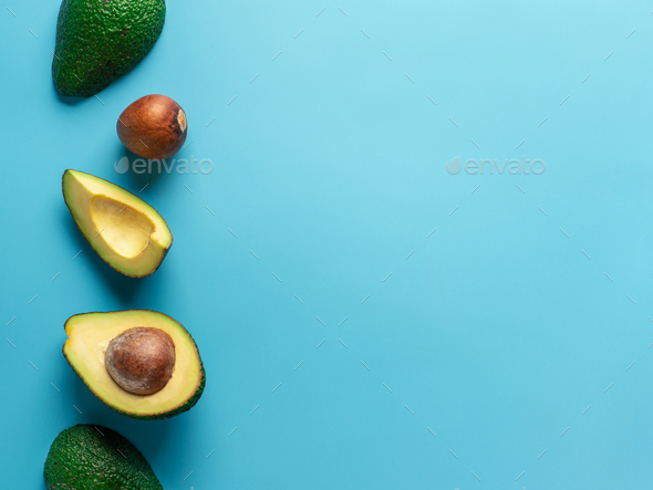 Avocado with copy space, top view, blue background - Stock Photo - Images